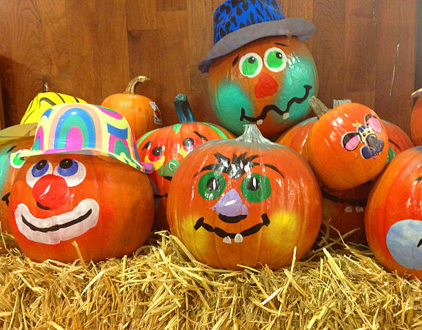 halloween decorated pumpkins - decorating stock photos and pictures