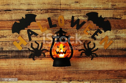 Halloween decoration for every child. National holiday is coming. Terrifying and ominous ghosts. Word Halloween written on old dusty board by paper letters. Trick and treat.