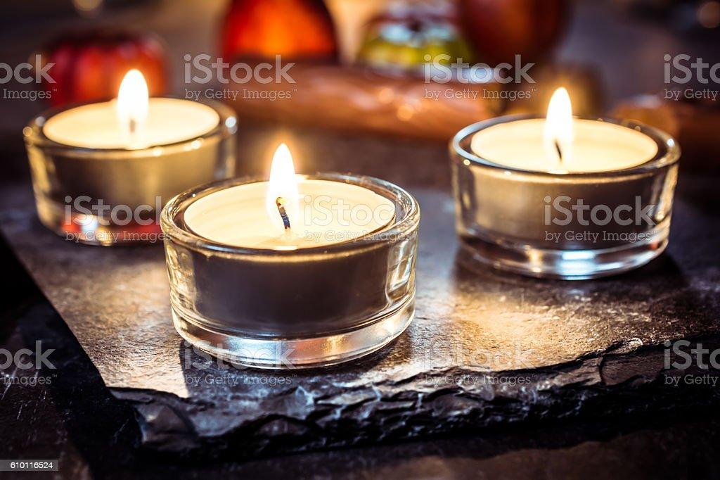 Halloween Decoration With Three Tealights, Chocolate And Pumpkin stock photo