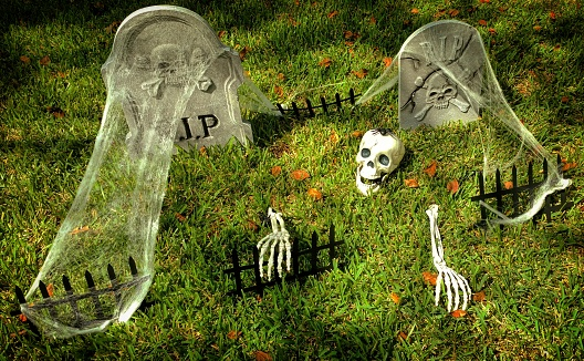 Halloween Decorations of a Skeleton with a Spider on Its Head Climbing Out of a Grave