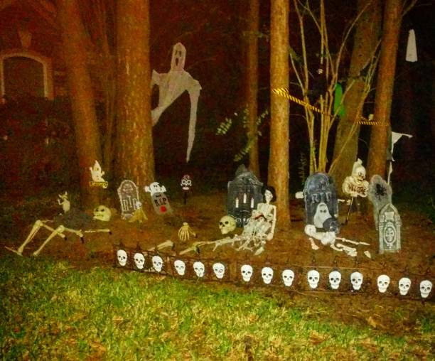 Halloween Decorations on Front Lawn at Night stock photo