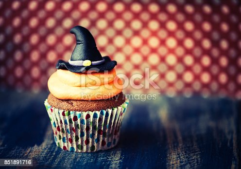 istock Halloween design cupcake on dark background 851891716