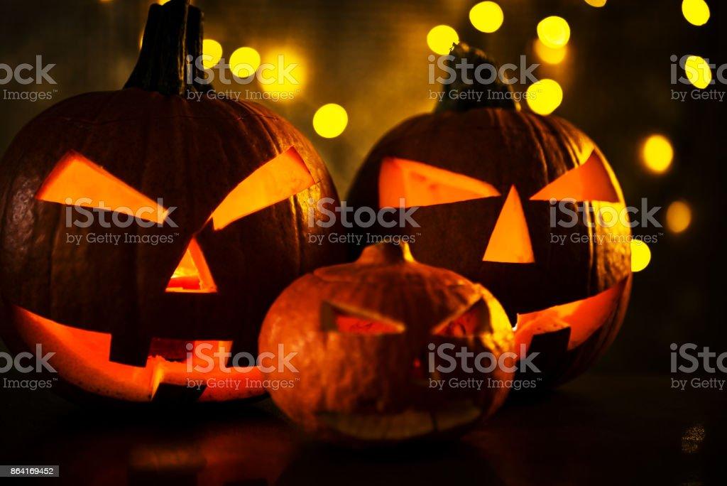 Halloween design with pumpkins. golden bokeh royalty-free stock photo