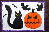 istock Halloween drawing:  Black cat, bad pumpkin and flying bats 866782220