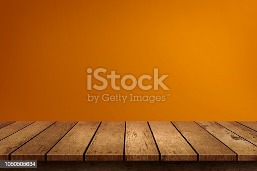 istock Halloween empty wooden tabletop on orange background. Use for product display montage. 1050505634
