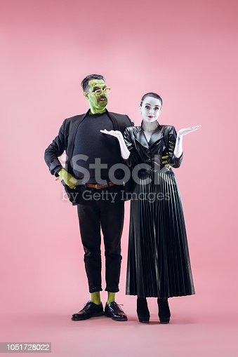 istock Halloween Family. Happy couple in Halloween Costume and Makeup 1051728022
