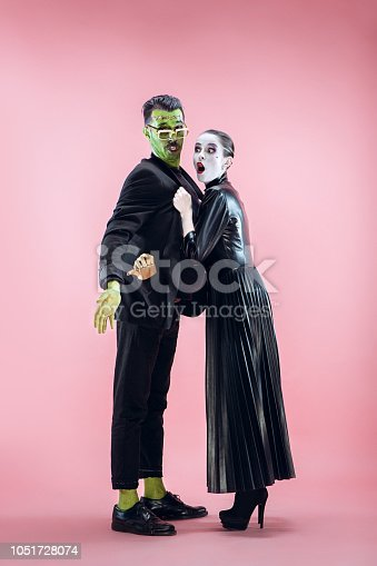 istock Halloween Family. Happy couple in Halloween Costume and Makeup 1051728074