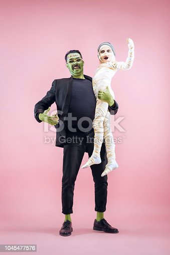 istock Halloween Family. Happy Father and Children Girl in Halloween Costume and Makeup 1045477576