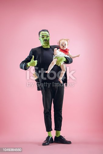 istock Halloween Family. Happy Father and Children Girl in Halloween Costume and Makeup 1049384550