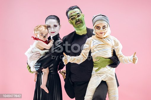 istock Halloween Family. Happy Father, Mother and Children Girls in Halloween Costume and Makeup 1045477642