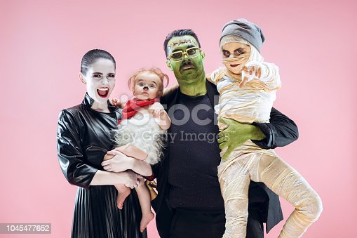 istock Halloween Family. Happy Father, Mother and Children Girls in Halloween Costume and Makeup 1045477652