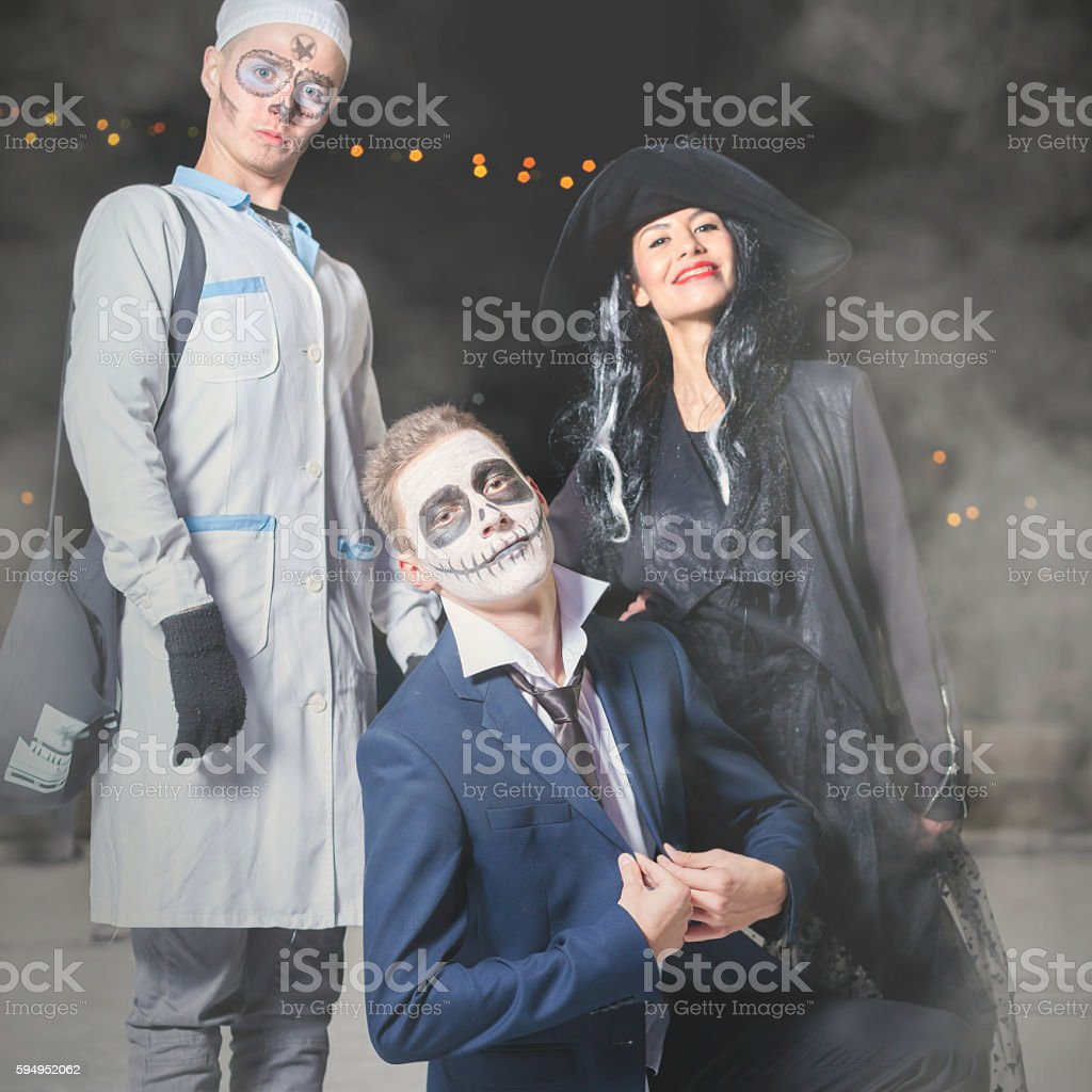 Halloween fancy dress of witch, doctor, Jack - master pumpkin stock photo