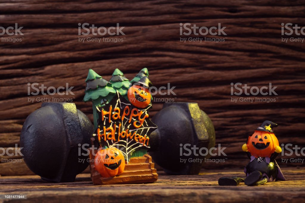 Halloween festival Head Doll Pumpkins haunted spooky and the black iron dumbbell. Fitness, healthy active lifestyle on Halloweeen day concept. stock photo