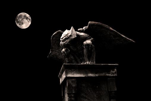 Gargoyle isolated on black background