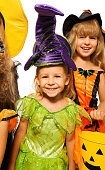 istock Halloween girl in fairy costume with friends 523576813