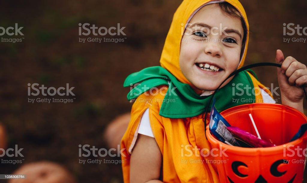 Halloween girl out for trick-or-treating stock photo