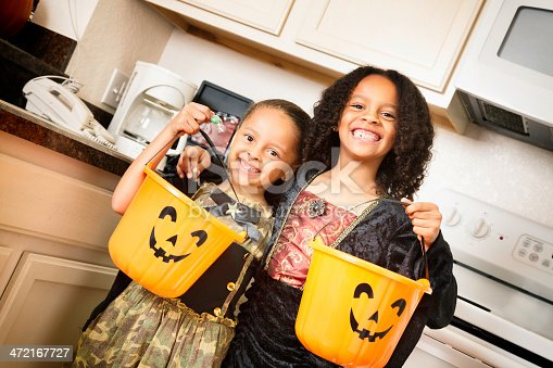 Two young girls ready to go trick or treating.