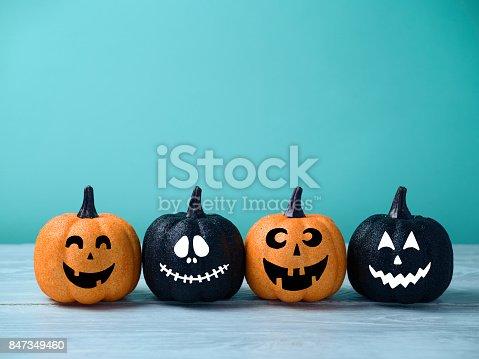istock Halloween glitter pumpkin jack o lantern decor 847349460