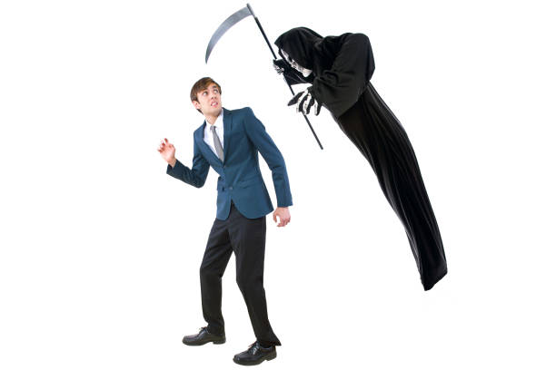 Halloween Grim Raper Chasing a Businessman on a White Background stock photo