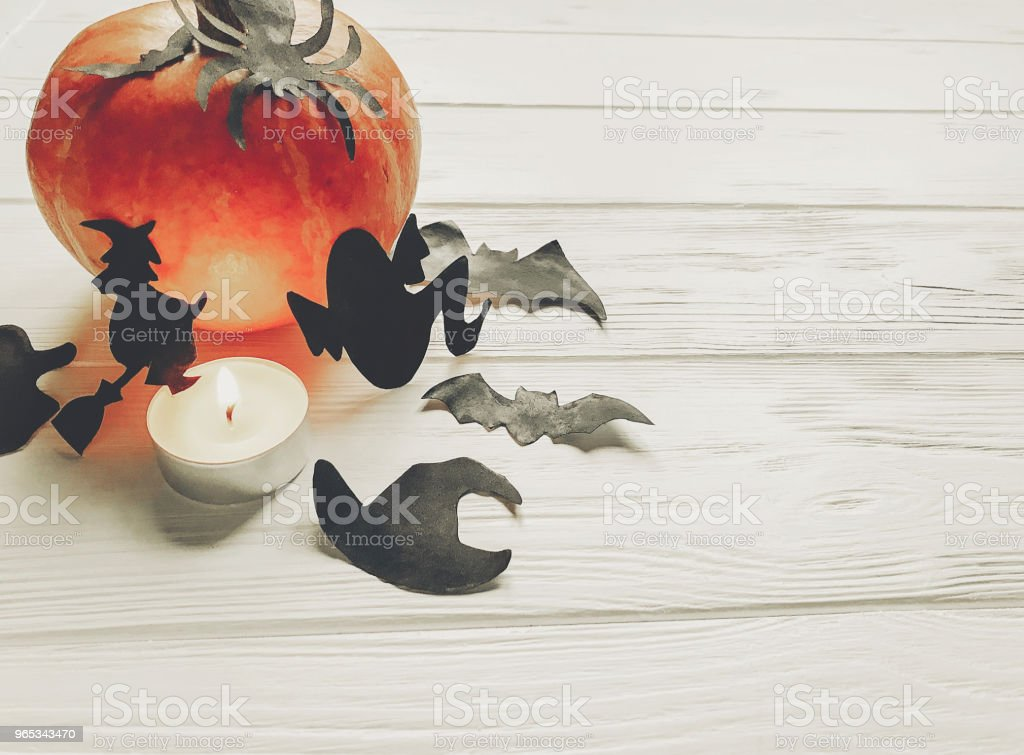 halloween. happy halloween concept. pumpkin with witch ghost bats and spider black decorations on white wooden background. cutouts for autumn celebration. seasonal greetings. space text royalty-free stock photo