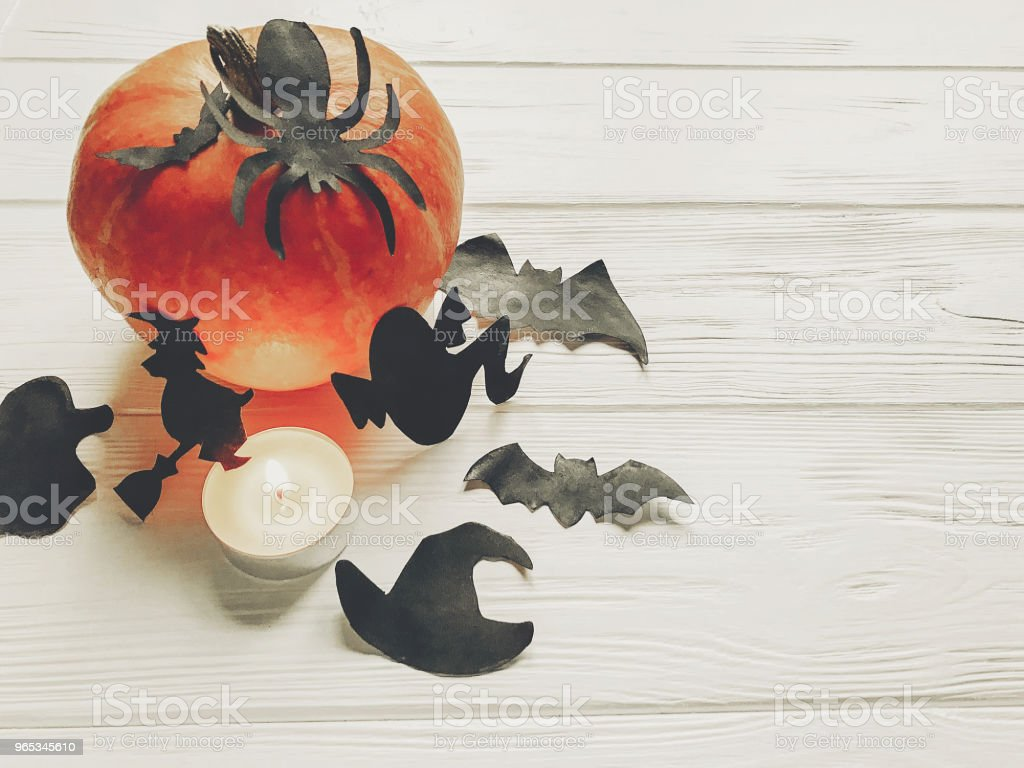 halloween. happy halloween concept. pumpkin with witch ghost bats and spider black decorations on white wooden background top view with space for text. seasonal greetings, holiday celebration royalty-free stock photo