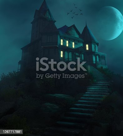 istock Halloween Haunted Manor on a Hill Against the Moon 1267717881