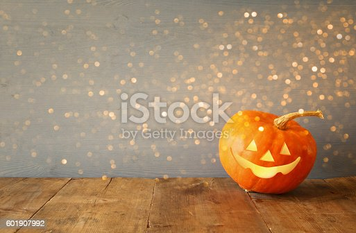 istock Halloween holiday concept. Cute pumpkin on wooden table 601907992