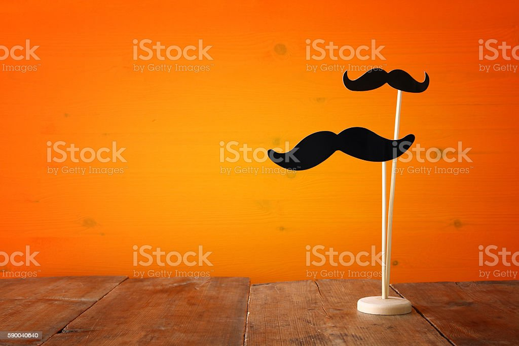 Halloween holiday concept. Funny paper moustache stock photo
