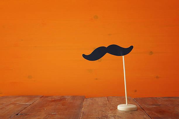 halloween holiday concept. funny paper moustache - schnurrbart fotoautomaten stock-fotos und bilder