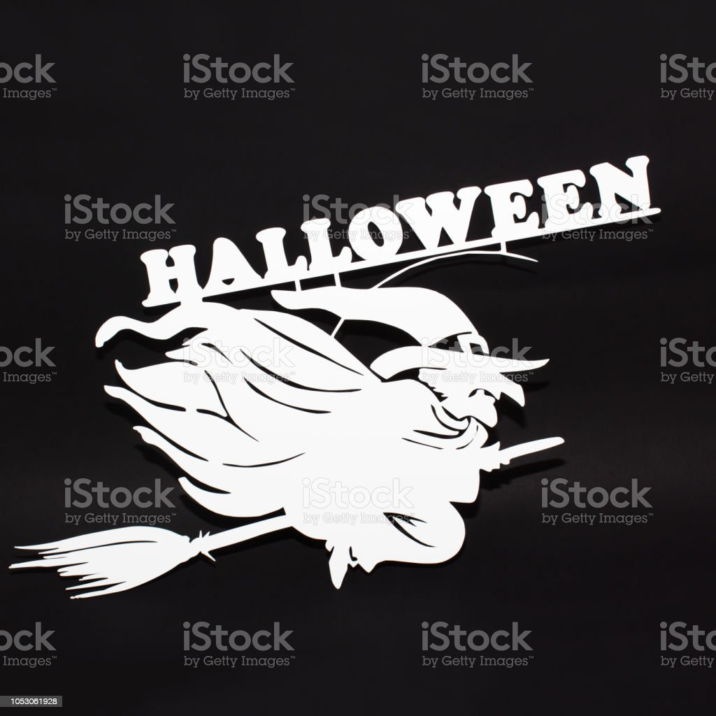 Halloween holiday metal top view image of witch over black background stock photo