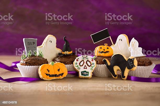 Halloween homemade cookies and cupcakes on purple spider backgro picture id485104978?b=1&k=6&m=485104978&s=612x612&h=bh9rrymve3qb9xl8nxipenu3y52ac mhzkcme s2ncw=