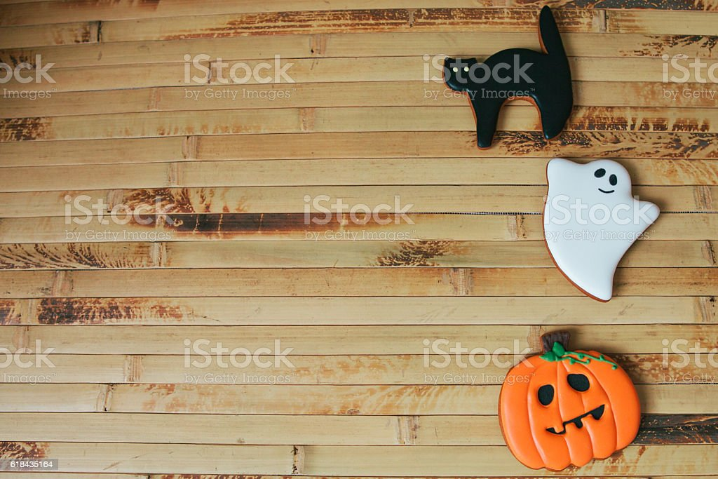 Halloween homemade gingerbread cookies on wood table stock photo