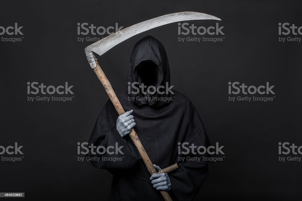 Halloween image of the death reaper on a black background stock photo