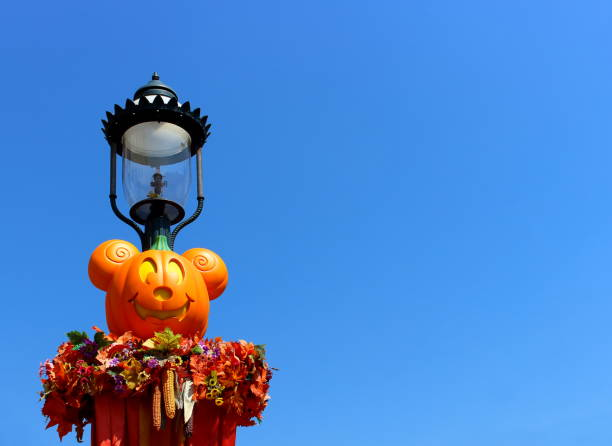 Halloween in Disneyland Hong Kong, China - 5 October 2018: Street lamp in Disneyland decorated with a Halloween celebration of a pumpkin in the form of Mickey Mouse, corn and autumn leaves new territories stock pictures, royalty-free photos & images