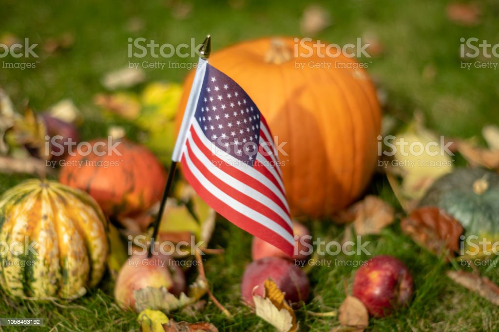Halloween in USA with stars and stripes flag and pumpkin stock photo