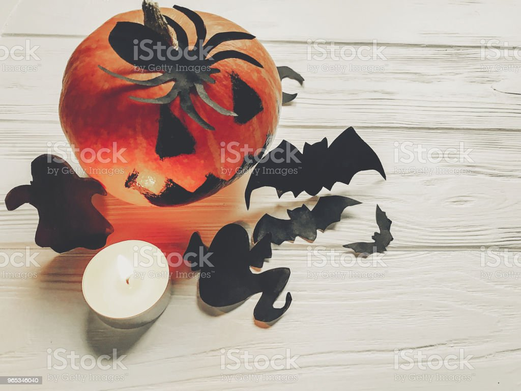 halloween. jack lantern pumpkin with witch ghost bats and spider black decorations on white wooden background. simple cutouts for autumn holiday celebration. seasonal greetings zbiór zdjęć royalty-free