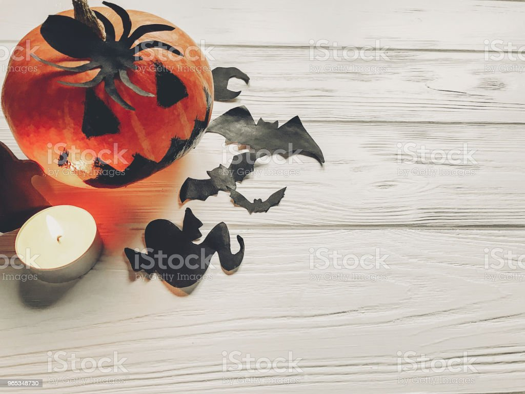halloween. jack lantern pumpkin with witch ghost bats and spider black decorations on white wooden background top view. seasonal greetings. happy halloween concept, holiday celebration zbiór zdjęć royalty-free