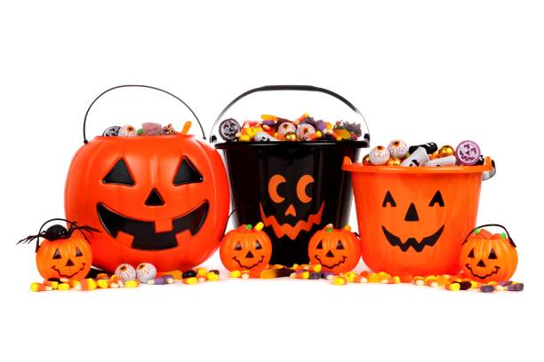 Halloween Jack o Lantern candy collectors isolated on white stock photo