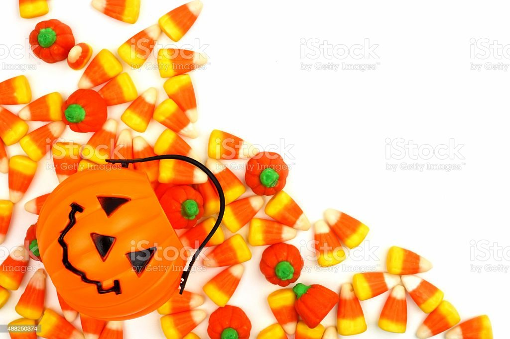 Halloween Jack o Lantern candy holder with candy corner border stock photo