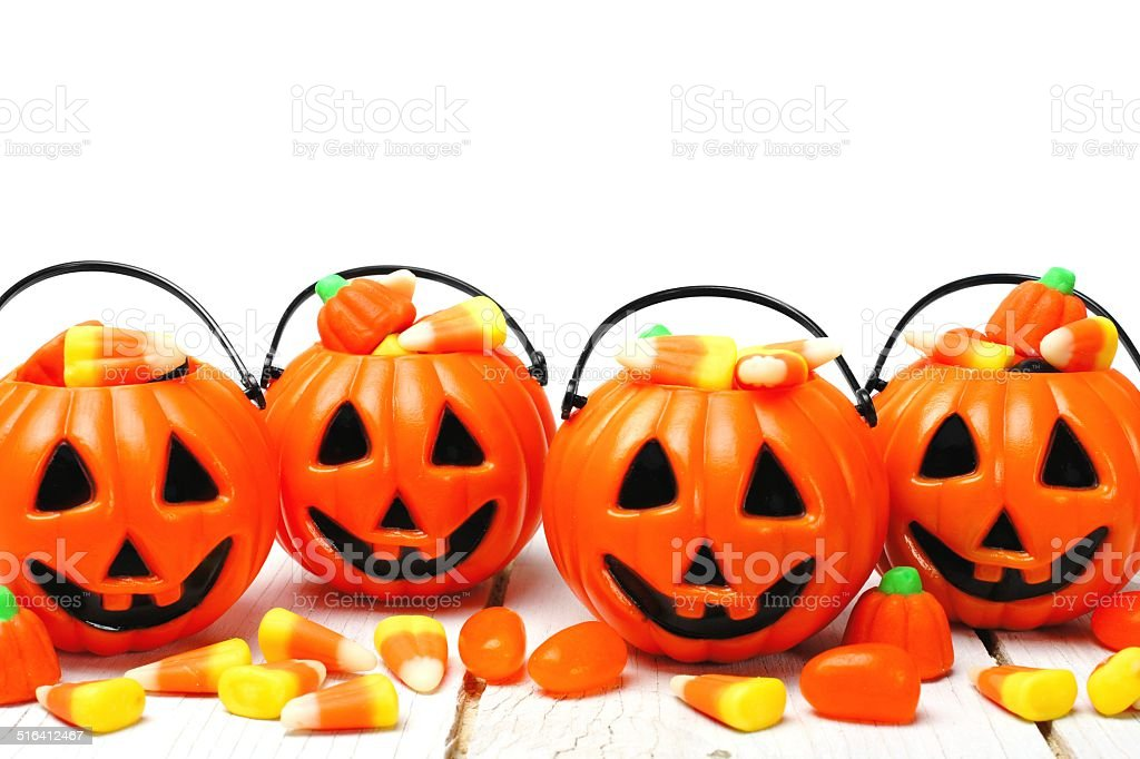 Halloween Jack o Lantern candy holders with candy corn stock photo