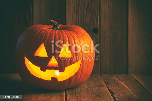 Halloween Jack O' lantern on rustic wooden background