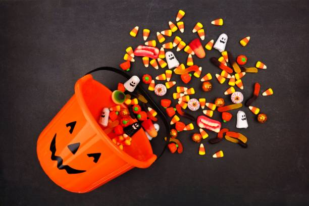 Halloween jack o lantern pail top view with spilling candy picture id1032890422?b=1&k=6&m=1032890422&s=612x612&w=0&h=2yfhri6tvgtwpejjrowrsspetyqzm6yrwbqpmti1oow=