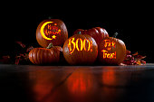 A trio of spooky messages carved into pumpkins.