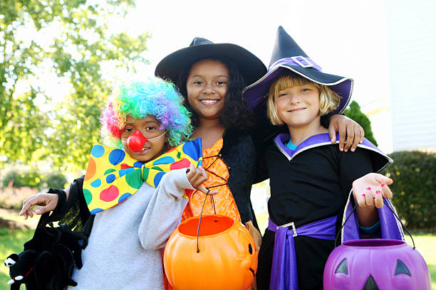 Halloween kids in costumes smiling stock photo