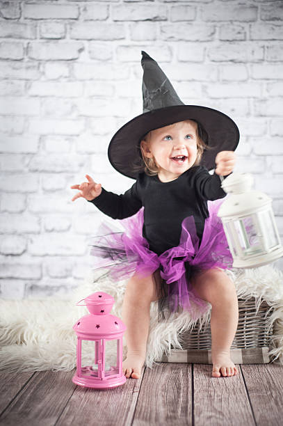 Halloween little girl witch with lanterns stock photo