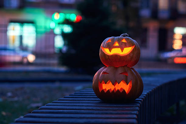 Halloween magic pumpkins at night stock photo