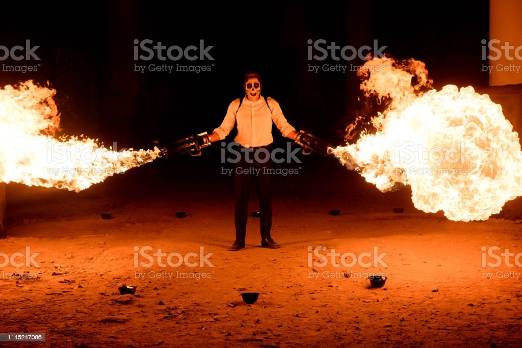 Halloween Maan.Halloween Man In Costume With Flamethrower In His Hands