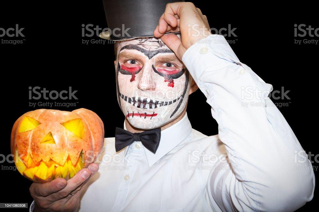 Photo De Stock De Homme De Halloween Avec Le Maquillage Tient