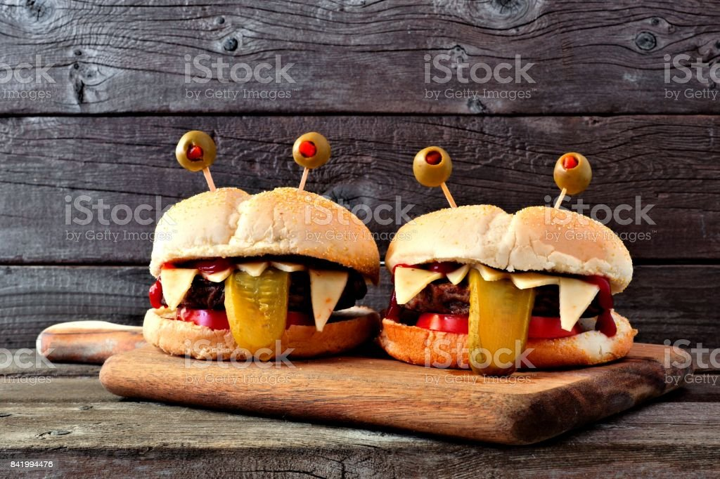 Halloween monster hamburgers against old wood stock photo