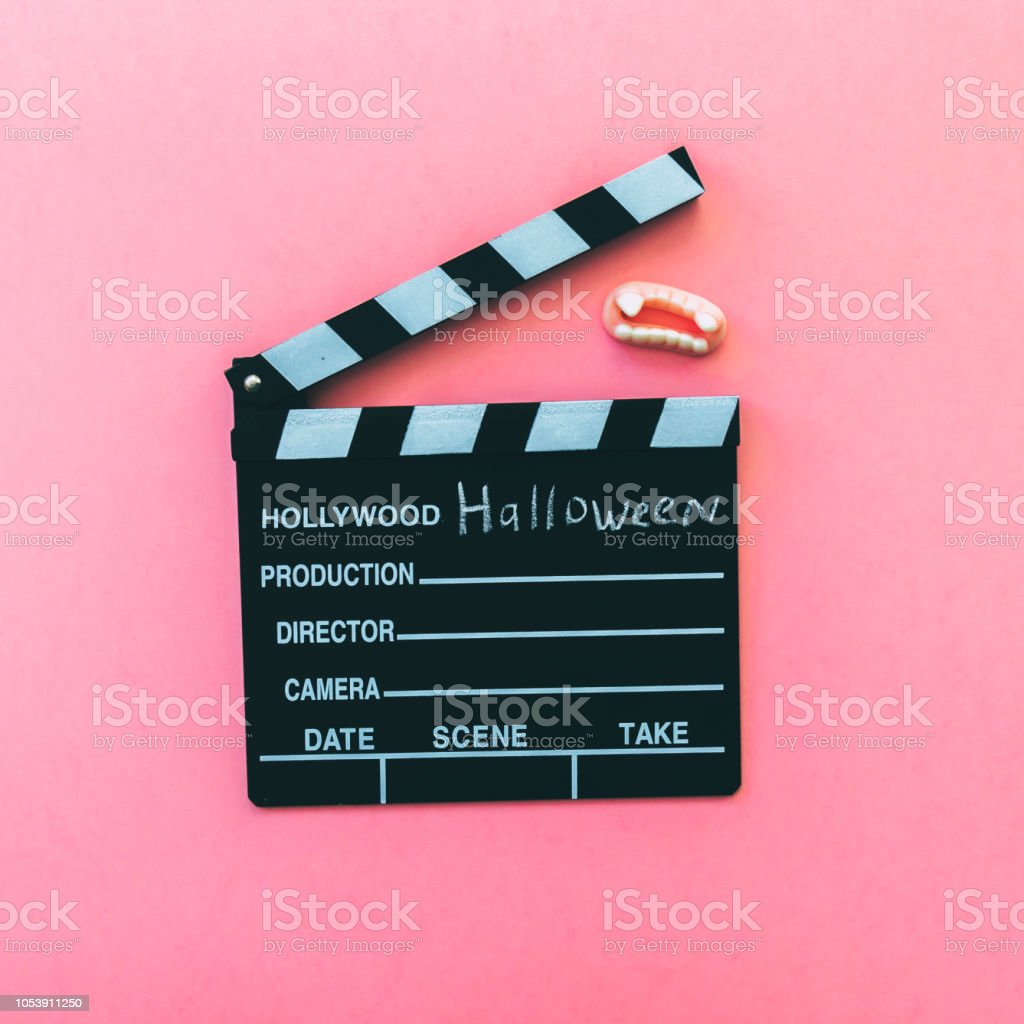 Halloween Movie Clapperboard And Vampire Fangs Candy Stock Photo